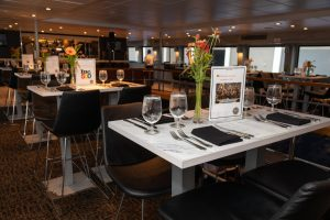 The dining setup with centerpieces on the Spirit of Boston.