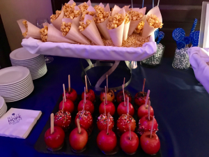 Caramel popcorn and candy apples, made custom from the Liberty Hotel.