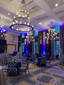 The Liberty Hotel Ballroon, with chandeliers, beautiful blue chairs and sparkling linen covering the tables.